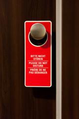 Do Not Disturb Label Hanging on Doorknob