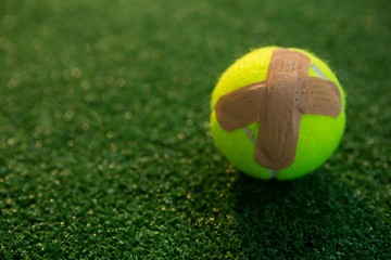 Close up of tennis ball with bandage