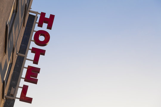 Generic Hotel Sign Attached to a Building Facade