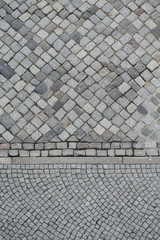 Background from two different patterns of cobblestones