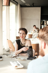 Elegant Young Woman Having Lunch at the Restaurant
