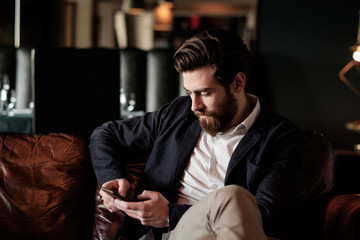 Handsome Bearded Man Using Phone