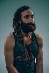 Man with braided dreadlocks and large beard.