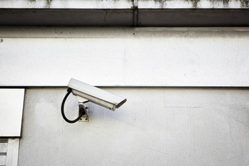 A security camera mounted on a wall