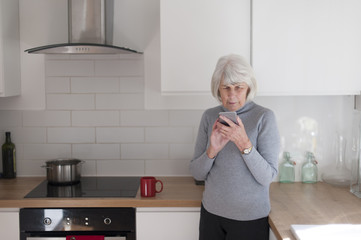 senior woman using a mobile device