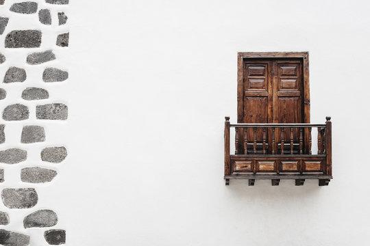 Wooden window door and balcony in a white wall. La Palma, Canary Island.