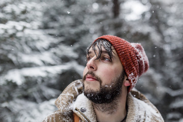Portrait of a man outdoors. Snowing