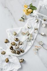 Quail eggs, butterflies and flower