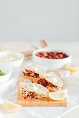 Tacos with azuki beans, salad and yogurt salsa