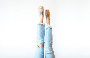 Female Legs with ripped jeans and sandals