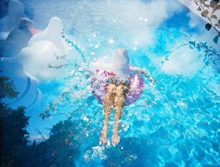 girl in floaty in pool with blue water double exposed with flowers