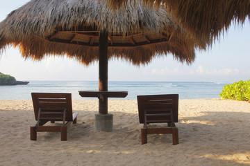 Chairs and umbrella. Bali.