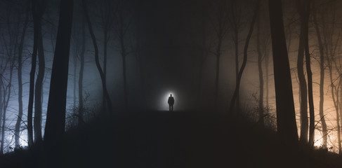 Man in surreal haunted forest on Halloween night