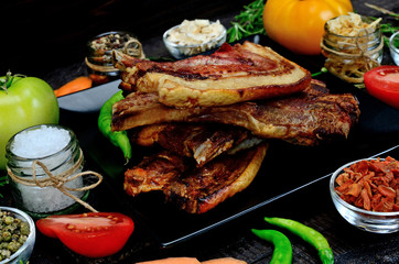 pork meat with vegetables on table
