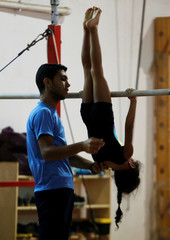 Girl trains during a practice session at a gymnastics school in Cairo