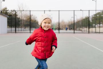 Little Chinese girl running