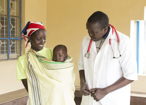 Doctor with mother and Baby. Kenya.