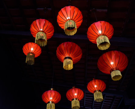 red paper chinese lanterns hanging on ceiling