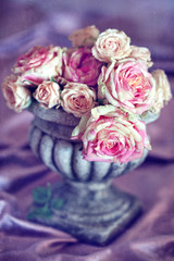 Still life with a fresh roses. Beautiful bouquet of roses in an antique vase.