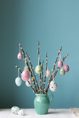Easter eggs hanging from pussy willow branches
