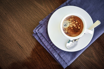 Espresso coffee in small white cup