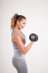 Fitness woman holding weights up