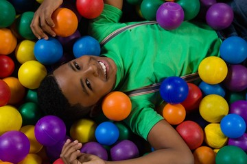 Overhead portrait of boy in ball pool
