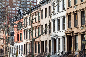 Row of historic brownstone buildings along a block in Manhattan, New York City