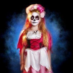 Portrait of a girl in  Halloween sugar skull outfit