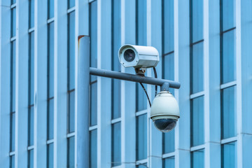 close-up view of security camera, in front of office building..