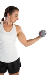 Young female rugby player lifting dumbbell