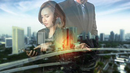 Double exposure photo Female and male hand touching modern smart phone Investment manager working new private banking project office.Using electronic device, City skyscrapers background