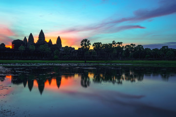 Cambodia  Angkor Wat landmark with reflection in water on sunrise