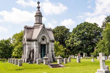 An elaborate mausoleum in a 19th century cemetery.