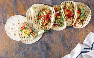Healthy corn tortillas with grilled chicken fillet and guacamole sauce