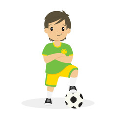 happy boy wearing green and yellow soccer jersey, with his arm crossed and his left foot on a soccer ball cartoon vector
