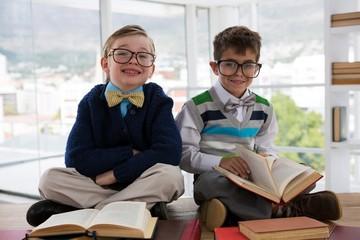 Obraz Kids as business executive sitting on a table - fototapety do salonu