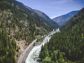 Aerial of Scenic Wilderness Highway by Mountain River