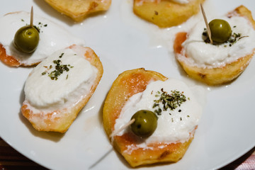 Table at home with pintxos and tapas.