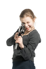 A girl in a gray sweater with a Kalashnikov in his hands. Isolated