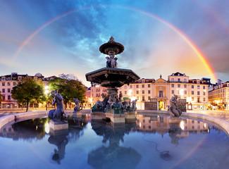 Rainbow over  Rossio square in Lisbon Portugal