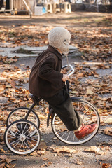 child on an old bicycle