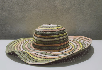 Colored straw hat on the table - Interiors (Pesaro, Italy)