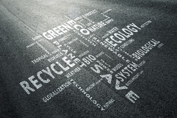 Asphalt road with conceptual eco friendly word cloud.