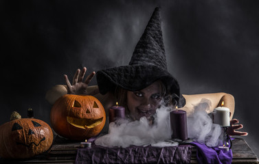 Attractive witch in the wizarding lair with smoke going from her mouth
