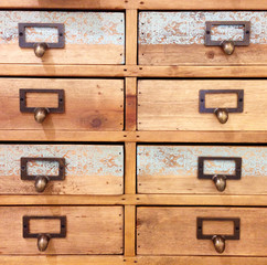 closeup wood chest of drawers vintage look