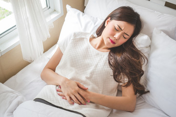 Asian woman stomachache, feel pain for period concept