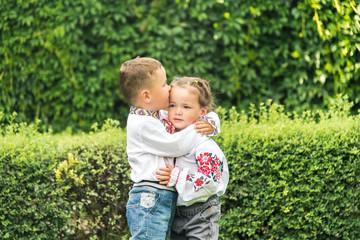 The boy kisses the girl