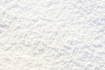 White texture of snow, shiny snowflakes smooth surface, winter background