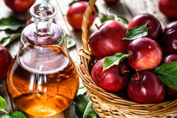 Apple cider or vinegar, bottle of drink and fresh apples, healthy organic food concept